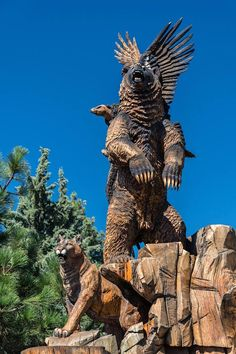 """This masterfully carved, five ton, 25 foot monument is a landmark called """"Harmony"""" in the high-elevation mountain town of Idyllwild, California. You really have to see it for yourself to really take in the beauty of this massive carving from a tree. Amazing talent!! The collection of life-sized native animals was carved with chainsaws into four large cedar trees that were glued together to create a raw block by local sculptor David Roy. It took him five years."""