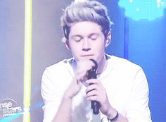 (gif) when he fiddles with his earpiece<3