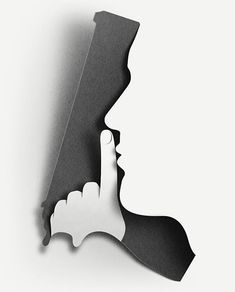 This design uses the figure-ground relationship principle by creating the shape of a hand gun with the silhouette of a face with a finger to its lips; whispering.