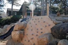 Eric and Shirly Lee White, of Boulder, Colo., have a slide, climbing wall and 'boulder...