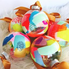 Each one uniquely painted work of art by Suze Ford. Bright colors of paint and a beautiful satin ribbon for a contemporary look! Teacher Ornaments, Holiday Ornaments, Glass Ornaments, Holiday Fun, Holiday Crafts, Christmas Decorations, Holiday Decor, Hand Painted Ornaments, Halloween Decorations