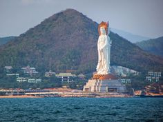 The Guan Yin statue in Hainan, China, has three sides with different poses: one side faces inland and the other two face the South China Sea. The stunning statue stands 354 feet high.