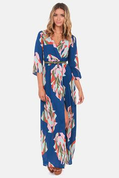 Check it out from Lulus.com! Uproot your normal routine and try the life of a trend-setting fashionista in the Day in the Life Blue Print Maxi Dress! A royal blue backdrop sets the stage for an abstract print in shades of pink, army green, and orange that dazzles from surplice bodice with three-quarter sleeves, to maxi-length hem. An elasticized waist flatters your figure above a flirtatious woven wrap skirt. Belt not included. Lined to mid thigh; sleeves are unlined. Model is wearing a size…