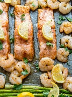 This Baked Salmon Shrimp and Asparagus recipe is a one-pan meal with salmon, shrimp and asparagus, with lemon and butter; seasoned with garlic.