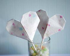 hart lollie van papier met een snoepje erin