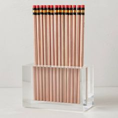 De-clutter your workspace with this cool Lucite pencil holder.