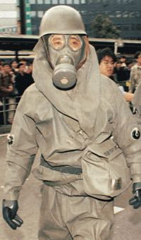 A police officer in protective gear responds to the 1995 Tokyo subway gas attack by Aum Shinrikyo. Tokyo Subway, Police Officer, World War, Death, Shit Happens, Libros