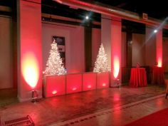 A vacant retail space is transformed ....becoming an event venue for one night with a holiday themed DJ booth from Dallas Light and Sound.