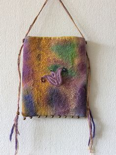 Another bag....the flower is hand stitched, the background is machine vermicelli, fun to do though you have to really concentrate to make it work well.
