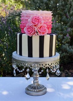 Black and white stripes, pink ombre ruffles, and pink roses.  I like the combo/contrast.