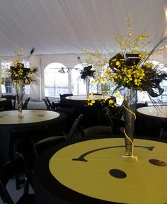 Pretty yellow oncidium orchid centerpieces by Sprout in Worcester, MA. How cute would it be to use the smile face theme for a bridal shower. Something very different and fun than traditional shower decor.