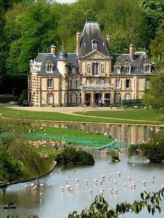 Chateau Sauvage, Emance, France.  This chateau was built of stone millstone and brick and roof slates. An English park of 40 hectares surrounds the Chateau.  Present day the Chateau is owned by the International Fund for the Preservation of Nature (IWPF) and its park is home to the wildlife sanctuary