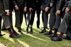 Fraser and his groomsmen paired their charcoal grey suits with black dress shoes and socks with differing patterns in the same color scheme. #groomsmen Photography: Laurie Bailey Photography. Read More: http://www.insideweddings.com/weddings/shabby-chic-garden-inspired-malibu-california-wedding/562/