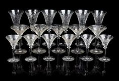* A Set of Etched Glass Stemware in three sizes. Height of tallest 8 1/2 inches. Estimate $ 300-500