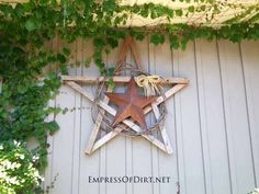 create star with reclaimed wood stakes, grape vine wreath, metal star, raffia bow