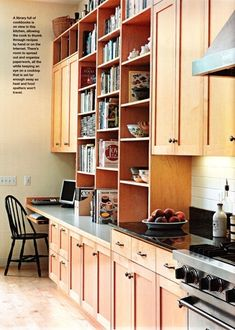 book shelfs in kitchen (great for cookbooks) - genius and it breaks up the massive un ending row of cabinets