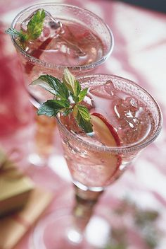 Noel Spritzer Recipe-WHITE WINE, CRAN-APPLE JUICE,SPARKLING WATER AND FRESH APPLE SLICES AND MINT, TO GARNISH