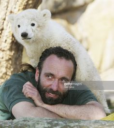 Knut the three-month old baby polar bear plays with his zoo keeper Thomas Doerflein under the cheering gaze of the public at the Berlin Zoo March 27, 2007 in Berlin, Germany.
