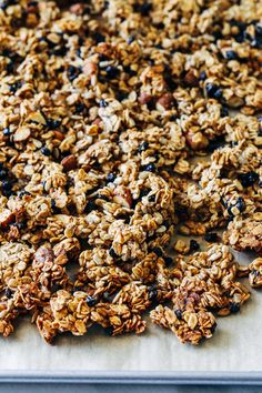 Chunky Blueberry Banana Granola- a naturally sweetened granola bursting with flavor from mashed banana, dried blueberries and almond butter. So chunky you would never guess it's made without oil! (vegan + gluten-free)