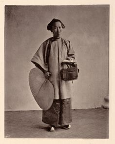 A maidservant to a Chinese lady in Canton, dressed to go out to do errands. The case is lacquerware and holds small cakes; the fan also protects her from the sun so she can stay pale. From John Thomson's Images of China (pub. 1873-74) http://ocw.mit.edu/ans7870/21f/21f.027/john_thomson_china ./tcc/