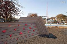 Big Ideas: School and Work | Polyurethane climbing holds are bolted to a wall at Kem Studios Académie Lafayette in Kansas City, Missouri. #design #interiordesign #interiordesignmagazine #architecture #playground #outdoor