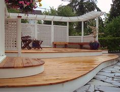 With wide deck steps, level change, curves, pergola and privacy screens, this deck project is fantastic.