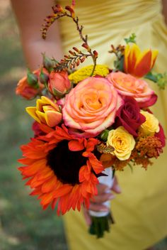 Fall orange, red, pink, and yellow bouquet with a red sunflower and yellow bridesmaid dress. Ladies and gentlemen, we have a winner!
