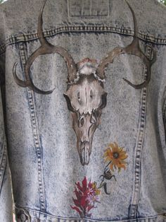 I painted a skull, a la Georgia O'Keeffe, on the back of a denim jacket. I never tire looking at this.