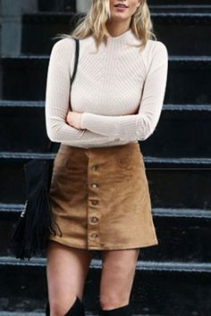 A ribbed sweater is paired with a button-front skirt