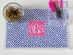 Free monogram printable for acrylic tray insert.  Choose color, type in your initials and hit print.  She also tells you where to buy the tray for cheap.  Great gift idea too!