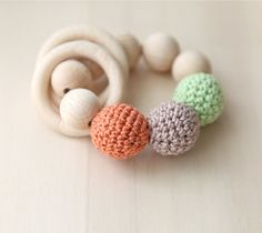Teething toy with crochet green, carrot orange,beige wooden beads and 2 wooden rings. Wooden rattle. Teething ring