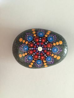A personal favorite from my Etsy shop https://www.etsy.com/listing/466274917/mandala-stone-hand-painted-rock-dot