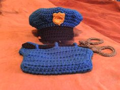 Cop Hat, Diaper Cover and Cuffs for 3-6 Months/Police Hat and Diaper Cover Pattern found at Busting Stitches, handcuffs are my own pattern