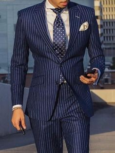 Let or design team at Giorgenti New York design your very own custom tailored blue pinstripe suit with white pocket square and tie. Come see us in our private Long Island showroom today for your mens style consultation. Der Gentleman, Gentleman Style, Best Street Style, Mode Costume, Dress Suits, Men's Suits, Blue Suits, Mens Fashion Suits, Men Street