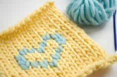 To add small motifs with wool to your projects, you can do so by doubling stitches, which is super easy and fast to do! Learn how to duplicate stitch here.