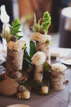 Rustic centerpiece @Nicole Toumazos, reminded me of the stuff you've been pinning for the wedding. :)