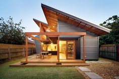 The roof rakes north to south to admit light without overshadowing the neighbours.