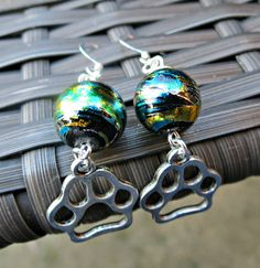 Dog and Cat Lover Iridescent Black Swirl PAW Charm Earrings by SparkleCatStudio.  Find us on Facebook: https://www.facebook.com/SparkleCatStudio  We donate 25% of our proceeds to animal rescues - The Humane Society of Alamance County OR The Biscuit Foundation.   We volunteer, foster, and are huge animal lovers!