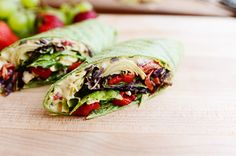 Hummus Wrap with carmelized onions, artichokes, roasted red peppers, feta, hummus, spring greens and vinaigrette.