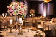Tall centerpieces of blush and ivory florals with touches of greenery by Layers of Lovely Floral Design. Las Vegas Wedding, Scheme Events, Ostara Photography, Dragon Ridge Country Club Wedding.