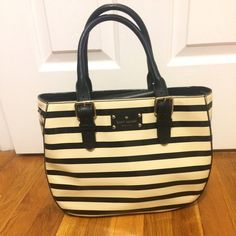 Kate Spade Patten Leather Purse NWOT.. Used less than a week. I found one I liked better.  Cream with black stripe patten leather. Black leather handles with silver buckles. Approx 12.5 in. In length. 9.5 in. Tall( not including handles). Snap enclosure. Comes with detachable black shoulder strap (perfect condition, never used, still in same hole that it came in) and dust sack. kate spade Bags
