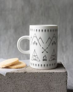 Adventure Awaits Tall Mug - A tall mug is a surefire conversation starter. Tents warming by the crackling fire are nestled amongst a backdrop of mountains and evergreens, beckoning you to get outside and enjoy the great outdoors. Surefire, Adventure Awaits, Get Outside, Tents, The Great Outdoors, Conversation, Mugs, Mountains, Studio