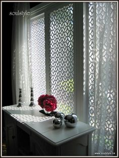 lattice from Acurio for window treatments   http://www.remodelaholic.com/2011/09/living-room-wainscot/