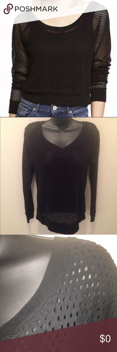 "Express Black Mesh Top Excellent condition.  Worn once.  Black long sleeve mesh top with scoop neck, banded hem and cuffs.  Inside labels have been removed but this is a size small.  Approx measurements laying flat:  chest 18"", length 24"". Express Tops Tees - Long Sleeve"