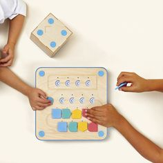 kids playing with cubetto interface board teaches preschoolers and kindergartners the first steps to coding