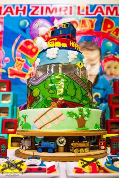 Thomas Train Birthday Party via Kara's Party Ideas: The Cake +Display Style