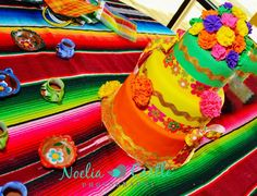 Mexican Fiesta Cake! I like the colors! With Flowers and Mexican Ribbon
