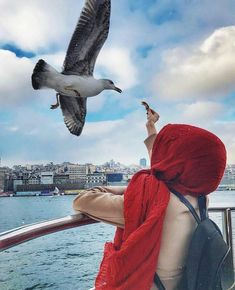 Image may contain: one or more people, sky, bird, cloud, outdoor and water -