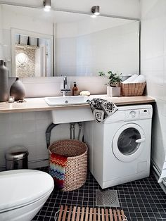 Scandinavian style practical bathroom. It saves the walk to the laundry room.