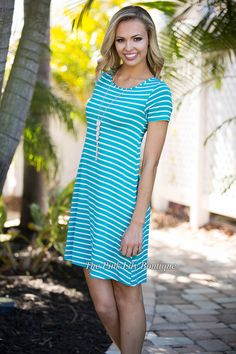 When you're going out, you want to be comfy and cute, and you can get that with this cute dress! It features white stripes, short sleeves, and made of the softest material! Perfect to wear with sandals or wedges!